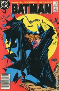 comic cover show a listing price of one dollar and shows Batman holding a women